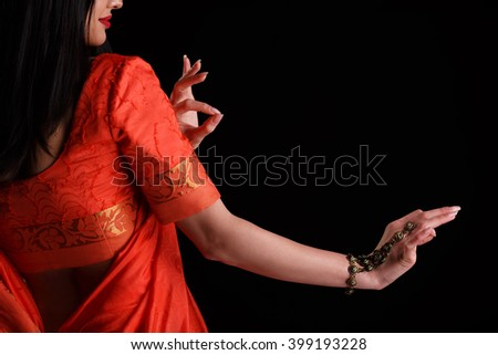 Beautiful young woman in traditional sari clothing with bridal makeup and jewelery. gorgeous brunette bride traditionally dressed in studio shoot. Girl bollywood dancer in Sari posing in studio. - stock photo