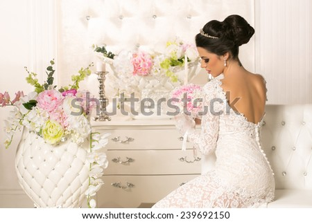 Beautiful young woman in wedding dress - stock photo