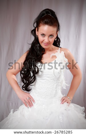 Beautiful young woman in wedding white gown.
