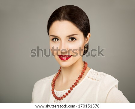 Beautiful Young Woman in White Blouse on Gray Backgound. Russian Beauty Concept. - stock photo