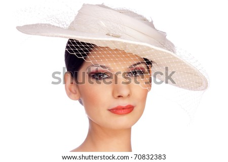 Beautiful young woman in white hat with net veil. Portrait, isolated on white background. - stock photo