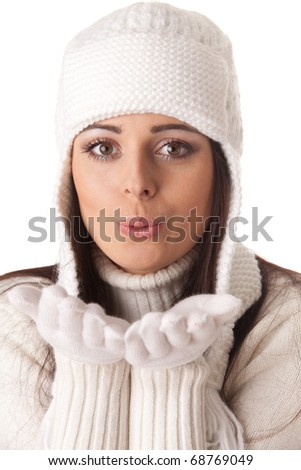 Beautiful young  woman in winter clothes on a white background.