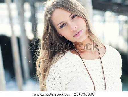 beautiful young woman in winter outdoors - stock photo