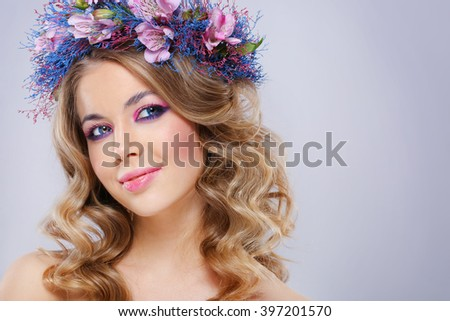 Beautiful young woman in wreath