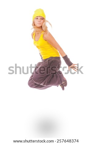 Beautiful young woman in yellow dress jumping, isolated on white background. - stock photo