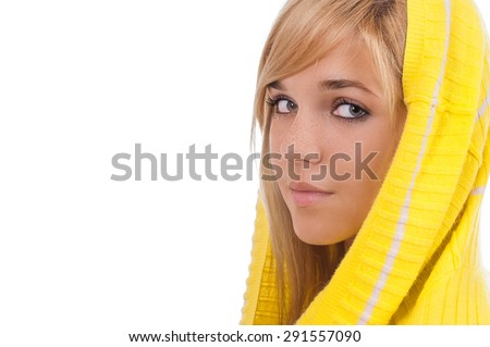 Beautiful young woman in yellow hood close up, isolated on white background. - stock photo