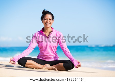 Beautiful young woman in yoga pose at the beach. Morning zen mediation outdoors. Practicing yoga. Healthy lifestyle. - stock photo