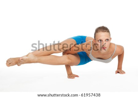 Beautiful young woman in yoga pose standing of her hands