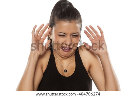beautiful young woman is disgusted by something - stock photo