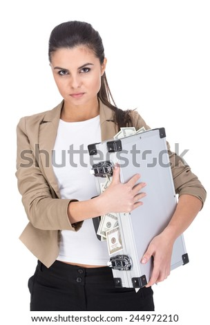 Beautiful young woman is holding a suitcase full of money, isolated on white background. - stock photo