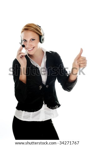 Beautiful young woman is receiving internet or phone calls on a headset. - stock photo