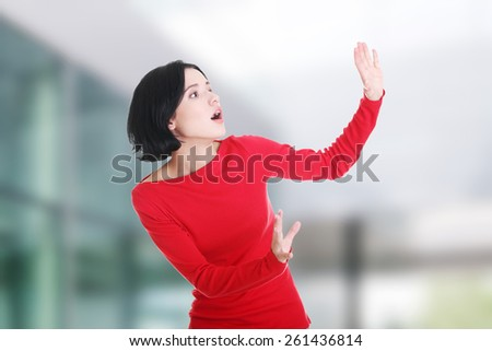 Beautiful young woman is scared - stock photo