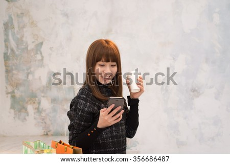 beautiful young woman is using smartphone device to send a text message