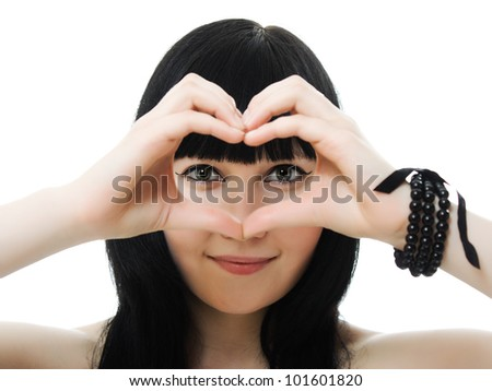 Beautiful young Woman isolated from the hands of a heart on white background - stock photo