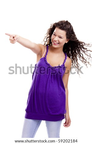 Beautiful young woman isolated on white pointing and looking to something - stock photo