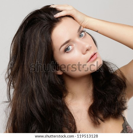 beautiful young woman isolated over gray background