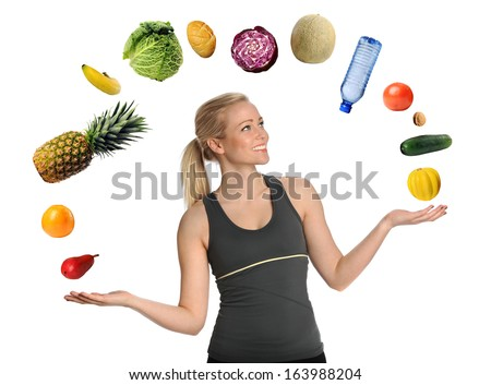 Beautiful young woman juggling fruits, vegetables and bottled water isolated over white background - stock photo