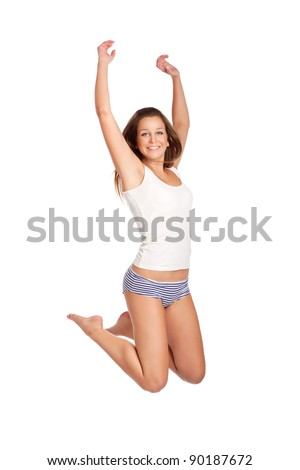Beautiful young woman jumping, isolated on white