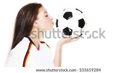 beautiful young woman kissing a football on white background - stock photo