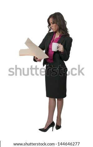 Beautiful young woman lawyer in a business suit holding a manila file folder