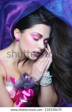 beautiful young woman lay on organza. Sleeping beauty. - stock photo