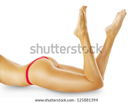 Beautiful young woman legs. Isolated on white. Perfect female body