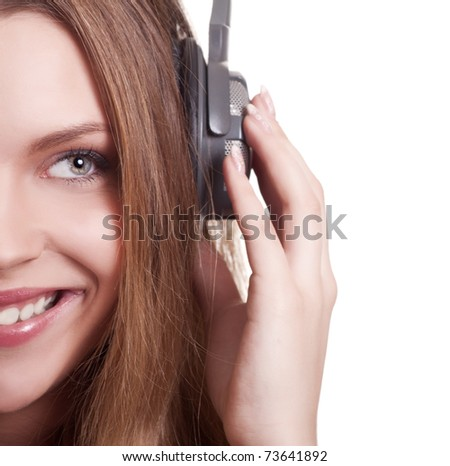 Beautiful young woman listen music with headphones - stock photo