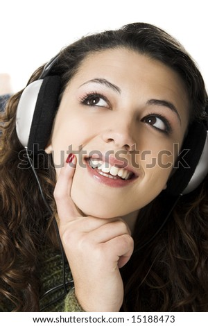 Beautiful young woman listening music with headphones