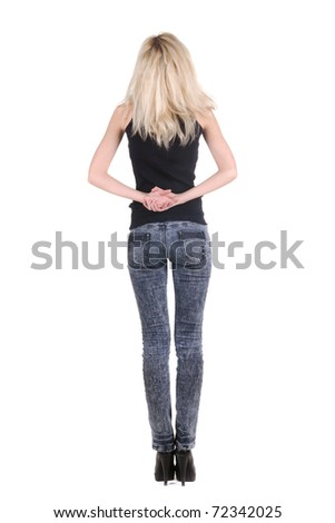 Beautiful young woman looking at wall. Rear view. - stock photo
