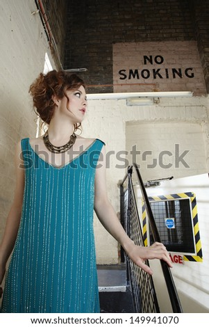 Beautiful young woman looking away in backstage - stock photo