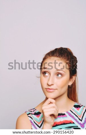 Beautiful young woman looking up with copyspace. - stock photo