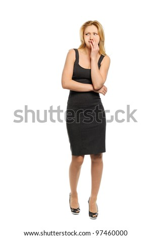 Beautiful young woman looks with displeasure - stock photo
