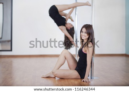 Beautiful young woman loving her pole fitness class - stock photo
