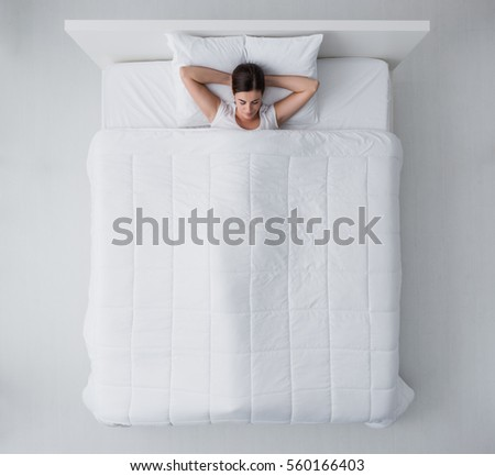 mattress top view. Beautiful Young Woman Lying Down In Bed And Sleeping, Top View Mattress