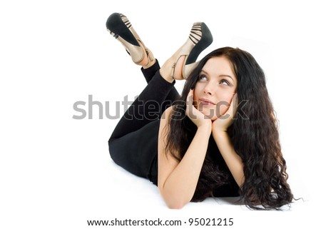 beautiful young woman lying on the floor and looking up - stock photo