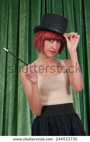 Beautiful young woman magician with a top hat - stock photo