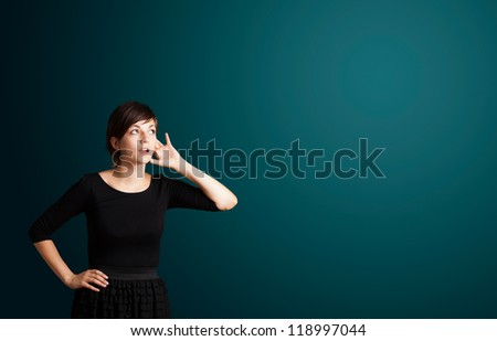 Beautiful young woman making gestures - stock photo