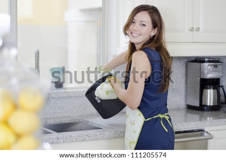 Beautiful young woman making some pasta