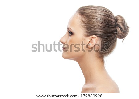 Beautiful young woman of profile, on white background.