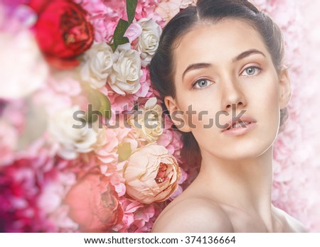 Beautiful young woman on a background of pink flowers. The concept of beauty and health. Beautiful fashion bride, sweet and sensual.  - stock photo