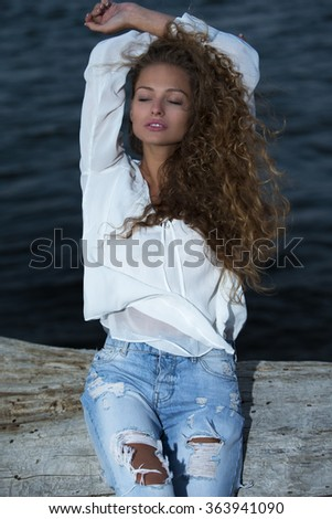 Beautiful young woman on a beach - stock photo