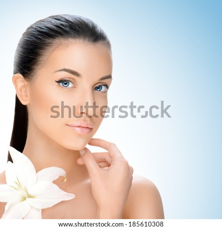 beautiful young woman on a blue background, beauty concept
