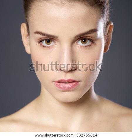 Beautiful young woman on a dark background - stock photo