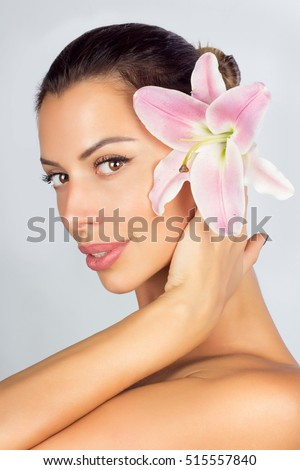 Beautiful young woman on a white background, beauty concept