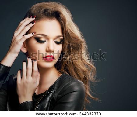 Beautiful young woman on dark background, beauty - stock photo