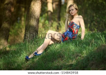 beautiful young woman on field - stock photo