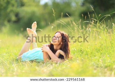 beautiful young woman on field in summer - stock photo