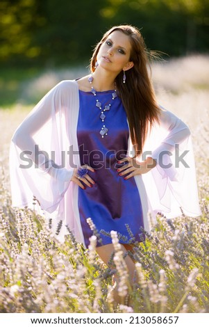 Beautiful young woman on lavander field - lavanda girl in early summer