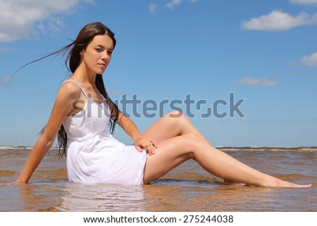 beautiful young woman on sea - stock photo