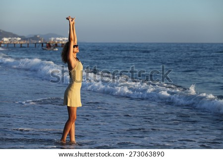 Beautiful young woman on sea water. Relax, vacation - stock photo